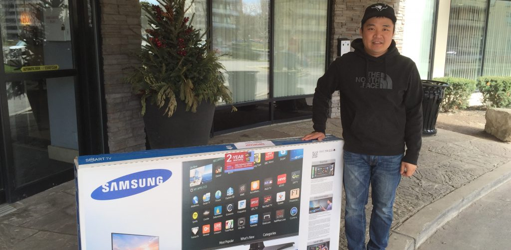 Peel Bong Kim of Design Air ClimateCare, Toronto, went home with a big-screen TV awarded by Plumbing & HVAC magazine in a draw.