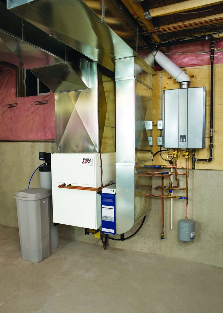 In this RedZone installation, a forced air furnace and water tank were replaced with a combo system to free up space.