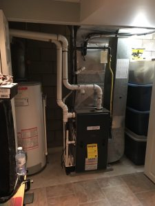 When installing a high efficiency furnace, if there is a gas water heater some consideration must be given on how to vent it. (Photos courtesy of ClimateCare)