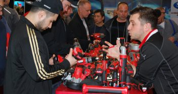 Visitors test out new tools at Mecanex 2017.