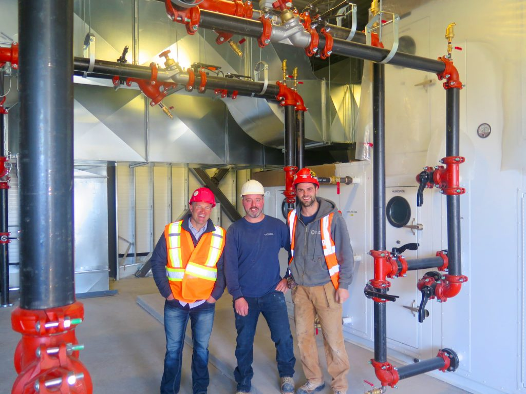 The Evolv1 project is just one of a number of ultra-efficient projects for Conestogo Mechanical, reported company president Wes Quickfall, at left, with sheet metal foreman Joe Golden and apprentice Brad Krouse.