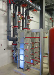 A heat exchanger protects both the system and the aquifer.
