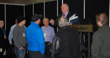 Sidney Manning, chief plumbing and gas administrator for Alberta Municipal Affairs, chats with contractors following a seminar on plumbing and building codes.
