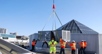 Sprint Mechanical employees install a new rooftop unit on a Toronto area mall.