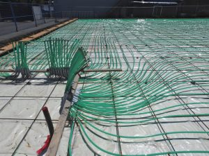 PE-RT for radiant heating tends to hold its shape when rolled out from the coil, say manufacturers.